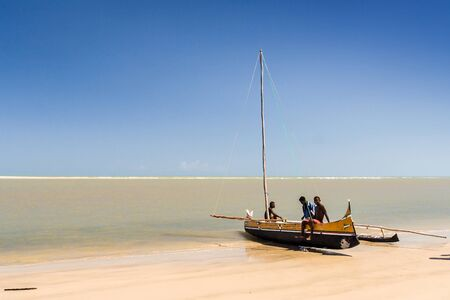 dugout: Malagasy people of ethnicity Vezo on his fishing canoe on oct 29, 2007 to Morondava, western Madagascar Editorial