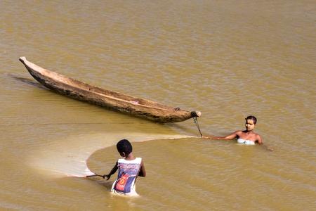 indigenous: Malagasy people fishing shrimp with net on oct. 29, 2007 near Morondava, Madagascar