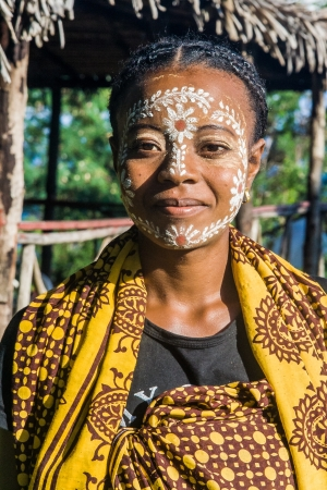 Malagasy woman of ethnicity  Sakalava with traditional paint mask on apr 8, 2008 in Nosy Be island, North of Madagascar.