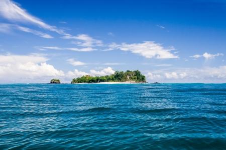 Deserted small island near Nosy Be, Madagascar photo