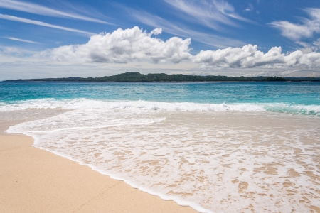 Tropical beach with wave on the sand in Nosy Be, Madagascar