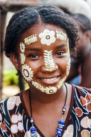 native african ethnicity: Sakalava young woman with his traditional beauty mask in Nosy Be, Madagascar on apr 4, 2008