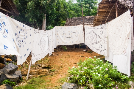 nosy: Selling embroidered tablecloths in Nosy Komba  Nosy Be , Madagascar