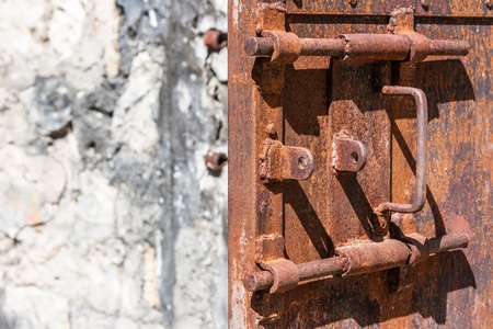 open gate: Old rusty lock of penal colony