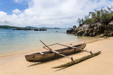 Outrigger canoe o the beach of Nosy Be, Madagascar