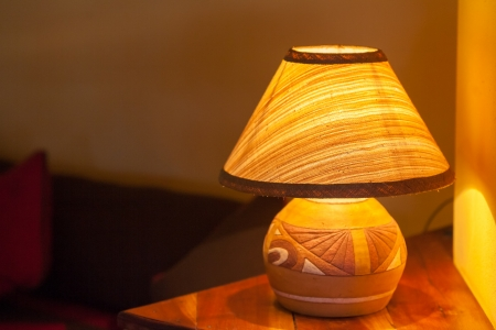 Bedside lamp and sofa in a luxury hotel
