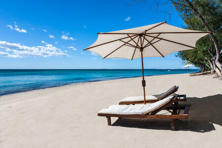 Sunbed and umbrella on a beautiful tropical beach photo