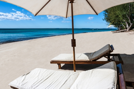 sunbed: Sunbed and umbrella on a beautiful tropical beach