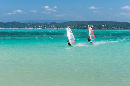 vastness: Couple of windsurfers in the vastness of the lagoon