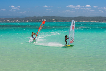 sports and recreation: Couple of windsurfers in the vastness of the lagoon