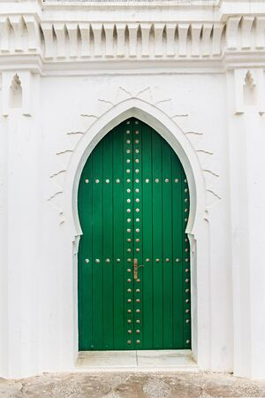 east gate: Moroccan door in the medina of Asilah, Morocco Stock Photo