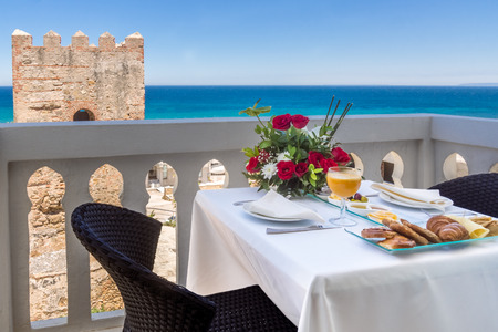 view on sea: Breakfast on terrace with view on sea Stock Photo