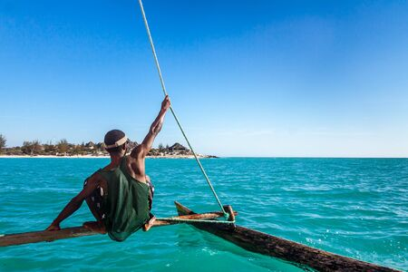 Vezo boatman on his outrigger canoe in the Ambatomilo lagoon in southwestern Madagascar on october 23, 2016