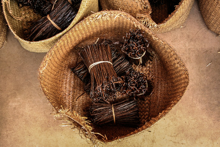 Bunches of Bourbon vanilla of Madagascar in craft baskets