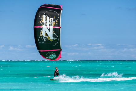 Salary, Madagascar, June 6, 2017: A kitesurfer surfing in the Ambatomilo lagoon, South of Madagascar