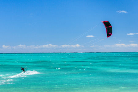 sailboard: Salary, Madagascar, June 6, 2017: A kitesurfer surfing in the Ambatomilo lagoon, South of Madagascar