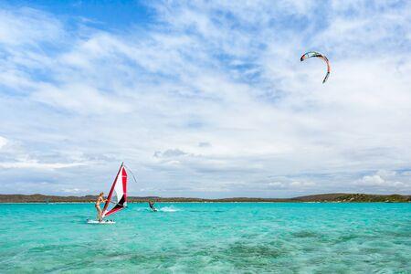 Antsiranana, Madagascar, july 9, 2017: A couple windsurfer and kitesurfer playing in the lagoon of Antsiranana bay (Diego Suarez)