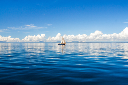 Dhow floating off Nosy Be, Madagascar Stock Photo