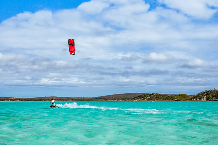 Kitesurfer playing in the turquoise lagoon of Diego Suarez, Madagascar.