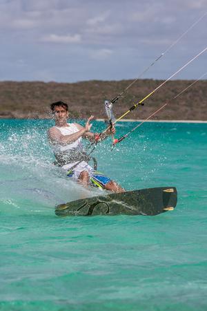 Kitesurfer enjoying his sport in the lagoon of Antsiranana bay, Madagascar