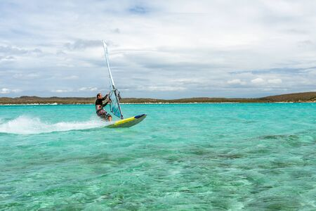 Mens windsurfer surfing in the lagoon