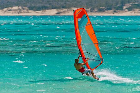 sailboard: Windsurfer playing in the turquoise lagoon Stock Photo
