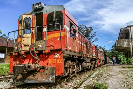 Fianarantsoa, Madagascar, March 7, 2013:  The engine of the FCE train (Fianarantsoa - East Coast) during a stop in a railway station