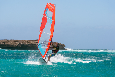 Windsurfer playing in the waves Banco de Imagens