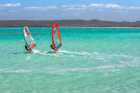 Couple of windsurfers in the vastness of the lagoon