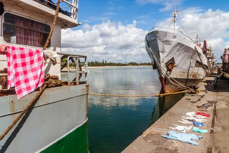 Drying laundry on the port of Toamasina (Tamatave), Madagascar Stock Photo