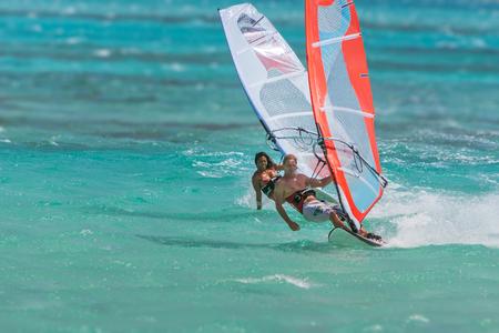 windsurf: Couple of windsurfers playing in the lagoon