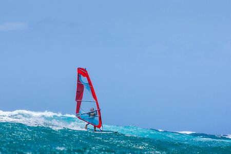 Windsurfer playing in the waves Stock Photo