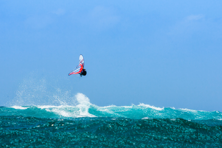 Windsurfer jumping in the waves