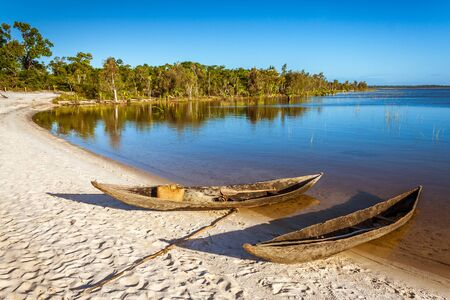 Dugout canoes beached on the Rasoabe lake, Pangalanes canal, eastern Madagascar