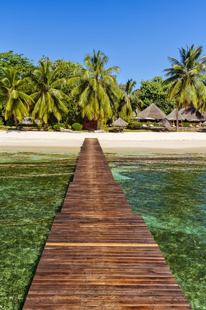 View of the tropical beach from  the wooden pontoon of Sainte-Marie island, East of Madagascar Фото со стока - 88062047