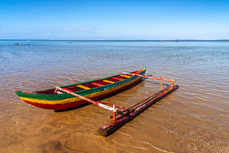 Outrigger canoe on the beach of Foulpointe, eastern Madagascar Stock Photo