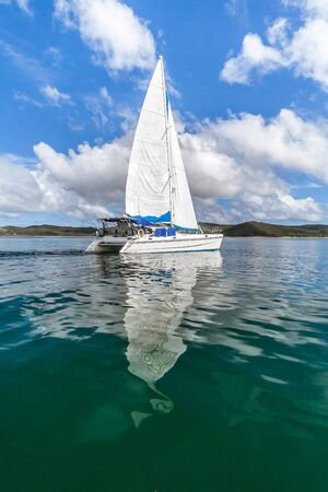 Luxury catamaran cruising in the Russians bay of Nosy Be, Madagascar