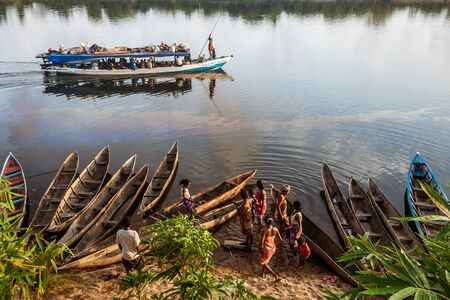 Andrevanto, Madagascar - November 10, 2016: Native people in a barge taxi along the Pangalanes Canal, eastern Madagascar