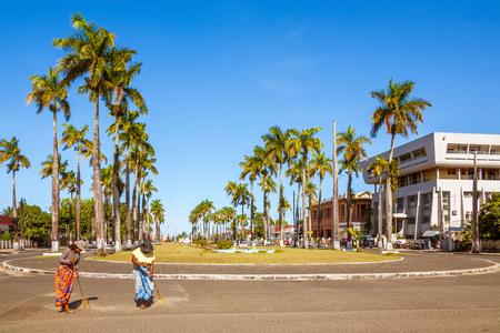 Toamasina, Madagascar, November 23, 2016: Malagasy women sweeping the Avenue of Independence of Toamasina (Tamatave), East of Madagascar