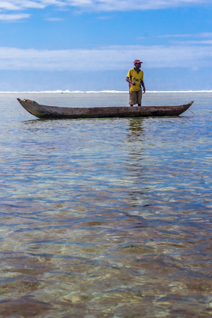 Sainte-Marie island, Madagascar, August 04, 2017: A fisherman a his dugout canoe fishing in the lagoon of Sainte Marie island.