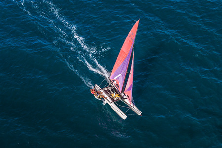 Nosy Be, Madagascar, June 26, 2017: Two sailors sailaing their hobie cat in the Indian Ocean