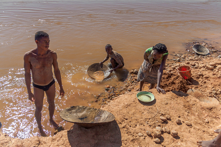 Malagasy gold panners in the river Tsiribihina, Western Madagascar on June 2017, 26