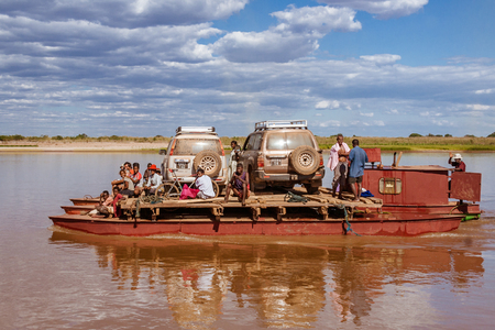Handmade ferry boat for crossing the river Tsiribihina of vehicles and people in Belo sur Tsiribihina, Madagascar, on June 30, 2017