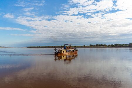 Tourists in a touristic barge along the river Tsiribihina, Western Madagascar on June 30, 2017