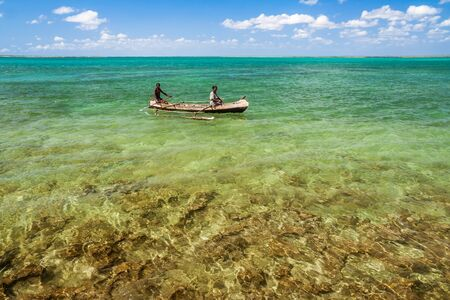 Malagasy couple in their outrigger canoe in the lagoon of Andavadoaka, Southwestern Madagascar on October 25, 2016