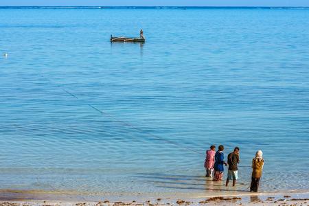 Tsifota, Madagascar, June 08, 2017: Fishing scene of Malagasy fishermen of the Vezo ethnic group in the edge of the Ambatomilo lagoon in southwestern Madagascar