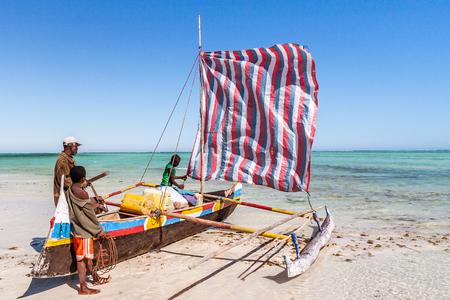 Ankasy, Madagascar, july 21, 2017: Vezo fishermen and their outrigger canoe on the beach of Ankasy, southwestern Madagascar