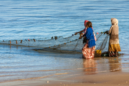 Tsifota, Madagascar, June 08, 2017: Fishing scene of Malagasy fishermen of the Vezo ethnic group in the edge of the Ambatomilo lagoon in southwestern Madagascar
