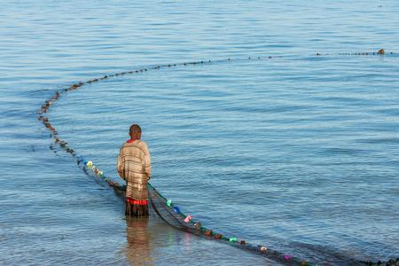 Tsifota, Madagascar, June 08, 2017: Fishing scene of Malagasy fisherman of the Vezo ethnic group in the Ambatomilo lagoon, southwestern Madagascar