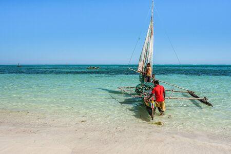 Tsifota, Madagascar,June 09, 2017:  Vezo fishermen and their outrigger canoe on the beach of Tsifota, southwestern Madagascar Editorial